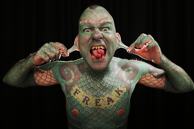 Eric Sprague - Almost all of his body is covered with green tattoos