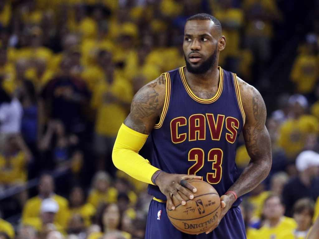LeBron James is 6′8″/203 cm and he weighs 238 lbs/108 kg