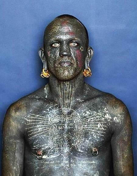 Rich has been confirmed 100% tattooed person by the Guinness World Records
