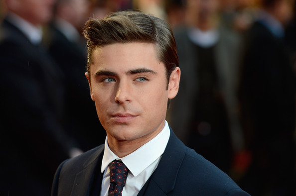 "Zac Efron is 5'8""/ 173 cm tall and he weighs 165 lbs/75 kg"