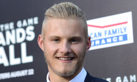 Alexander Ludwig's hair color is blonde and his eye color is blue