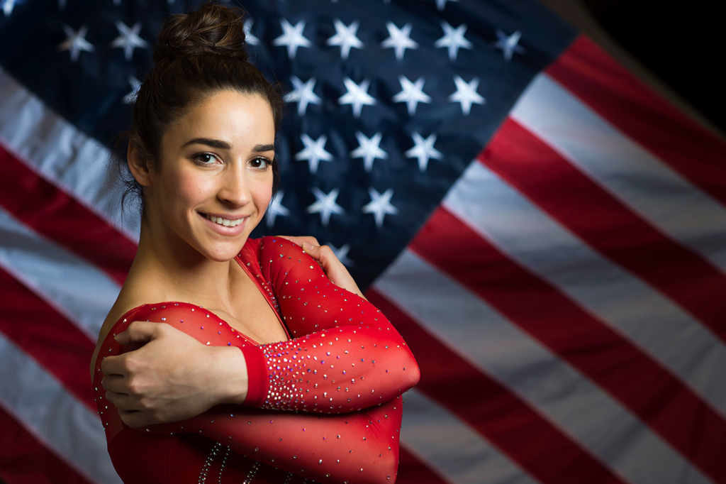"Aly Raisman is 5'2""/157 cm tall and she weighs 115 lbs/52 kg"