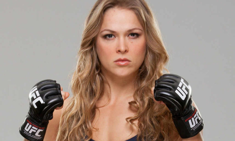 "Ronda Rousey is 5'7""/170 cm tall and she weighs 135 lbs/61 kg"