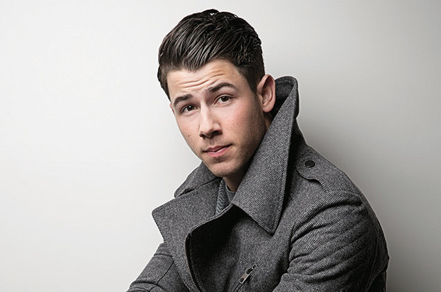 Nick's hair color is dark brown