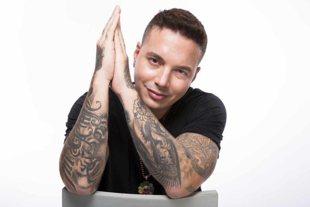 J Balvin's natural hair color is dark brown and his eyes are dark brown