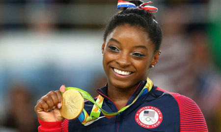 "Simone Biles is 4'8""/142 cm tall and she weighs 101.5 lbs /46 kg"
