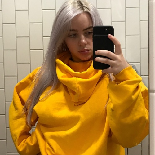 "Billie Eilish's hair color is blonde (Natural). She often dyes her hair different colors like 'platinum blonde', ""silver"", ""green"", etc."