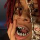 "Trippie Redd is 5'6""/167.5 cm tall and he weighs 139 lbs/63 kg"